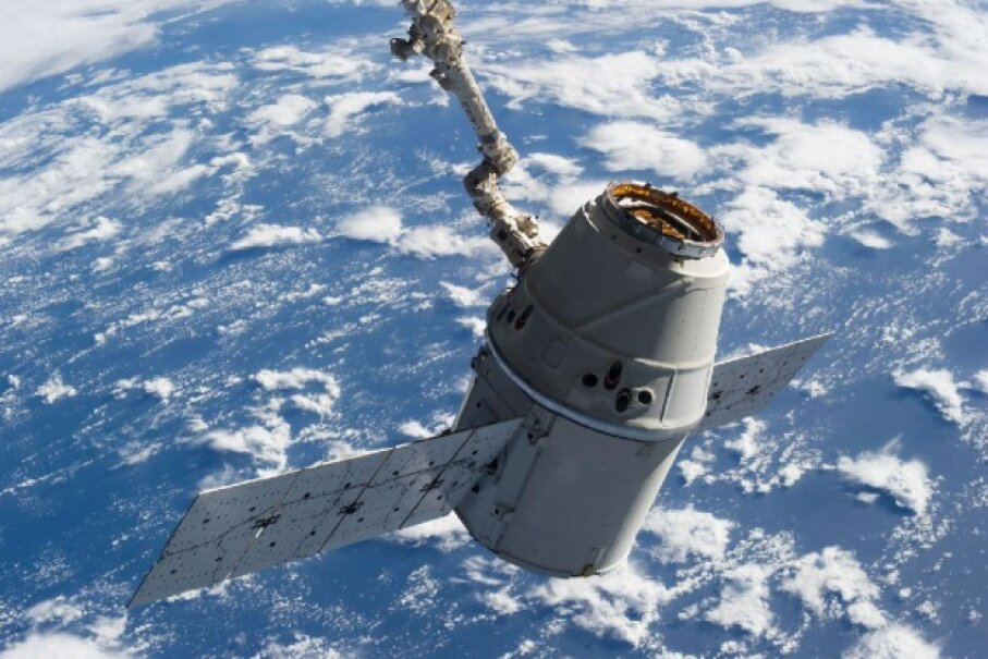 Victory! Earth forms the backdrop for this image, featuring Dragon-2 in the grasp of the International Space Station's Remote Manipulator System or Canadarm2 in March 2013. Image courtesy NASA