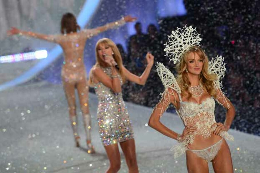 Model Lindsay Ellingson struts the runway in her 3-D-printed headpiece as Taylor Swift (center) sings during the 2013 Victoria's Secret Fashion Show. EMMANUEL DUNAND/AFP/Getty Images