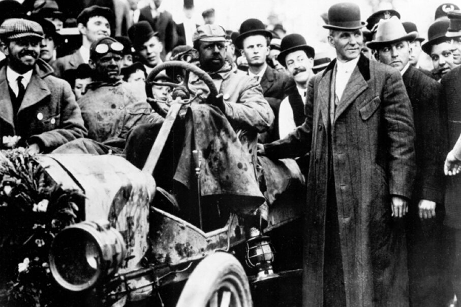 The first transcontinental car race from New York to Seattle was held in 1909 — Henry Ford's Model T won. The trip took 22 days and 55 minutes at an average speed of just 7.75 mph. (Henry Ford is shown standing next to the car.) (Courtesy of the Ford Motor Company)