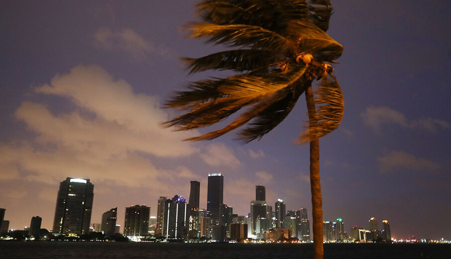 The skyline of Miami looms as Hurricane Irma starts to reach Florida on Sept. 9, 2017.
