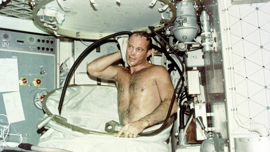 Jack Lousma, Skylab pilot, taking bath
