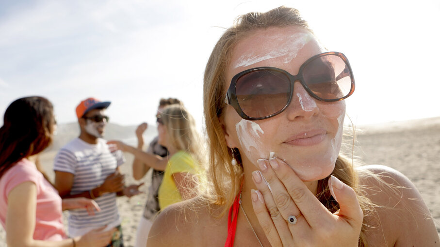 Person applying sunscreen