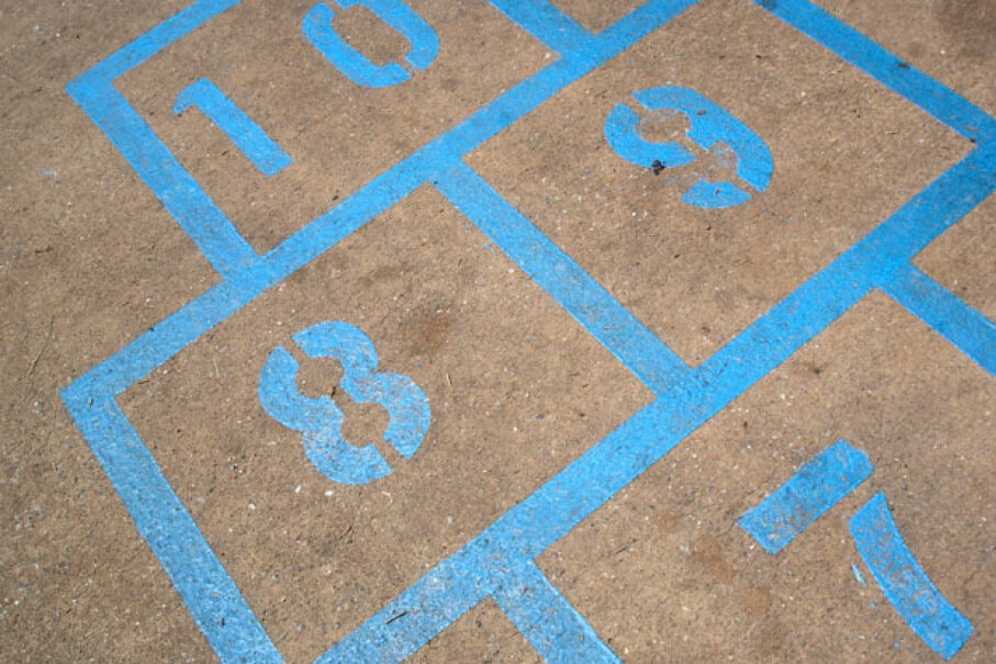 You can create your own hopscotch grid with chalk, but dedicated, painted hopscotch areas make it easy to jump right into exercise. ©iStockphoto/Thinkstock