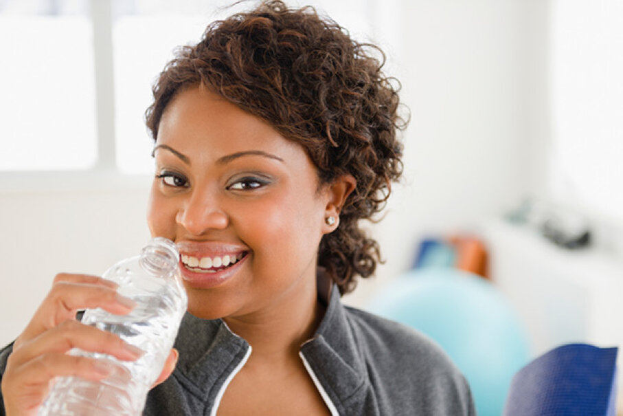 Drinking lots of water can actually help you lose weight. JGI/Jamie Grill/Blend Images/Getty Images