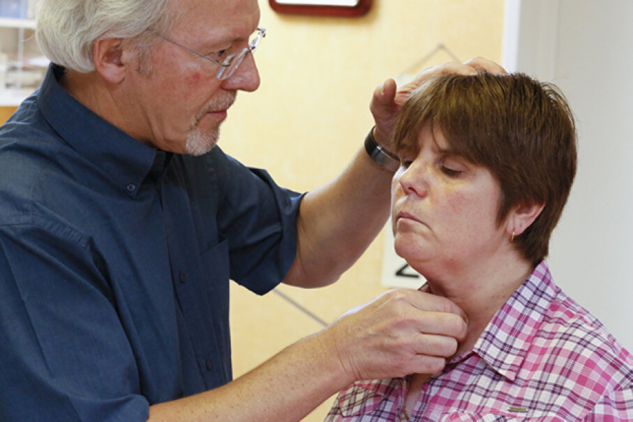 A doctor checks a woman's thyroid gland. Hypothyroidism can cause you to gain weight. BSIP/UIG via Getty Images