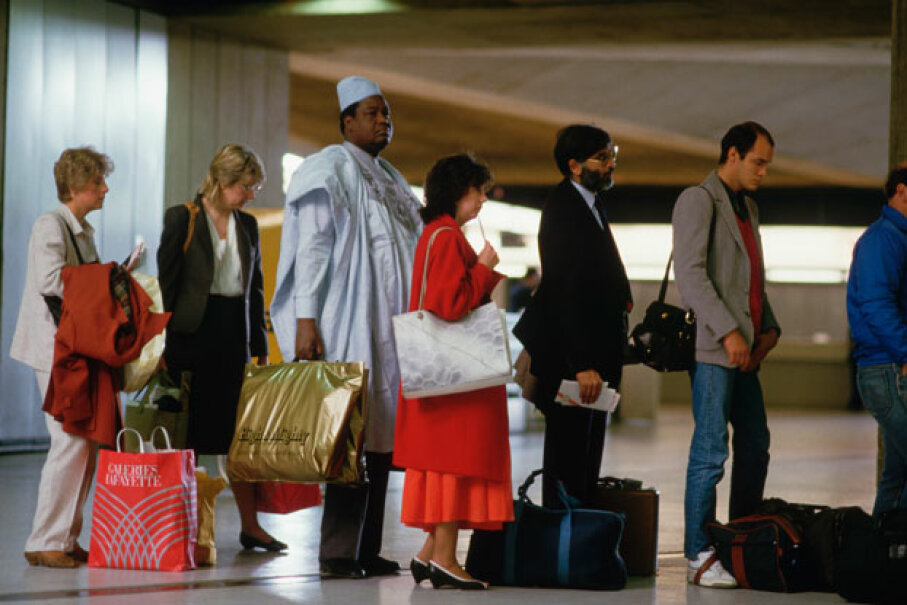 No one wants to stand in lines when they're traveling. You can avoid some of that wait time by taking advantage of the technology in your pocket. ©Peter Turnley/CORBIS