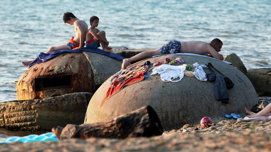 People sunbathe atop decrepit communist-era bunkers o