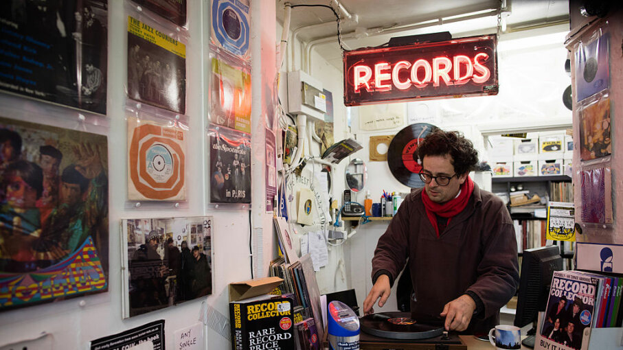A record dealer in Wanted Records in St Nicholas Market puts on a vinyl record on the shop's turntable on Oct. 14, 2015 in Bristol, England. Although sales of vinyl records declined dramatically with the introduction of digital formats such as CDs and downloads, they are now on a huge upswing.  Matt Cardy/Getty Images