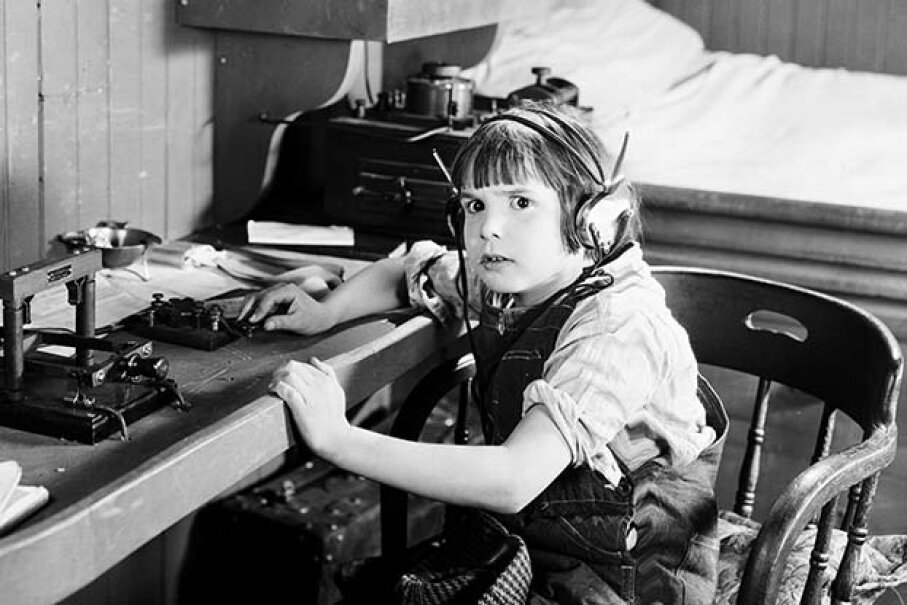 Actor Jackie Coogan looks a little scared to be using a telegraph machine in a scene from a 1924 movie. John Kobal Foundation/Getty Images