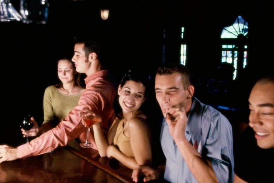 Spirits may give you the courage to talk to that attractive person in the bar, but it may very well make render you unable to perform sexually. ©Purestock/Thinkstock
