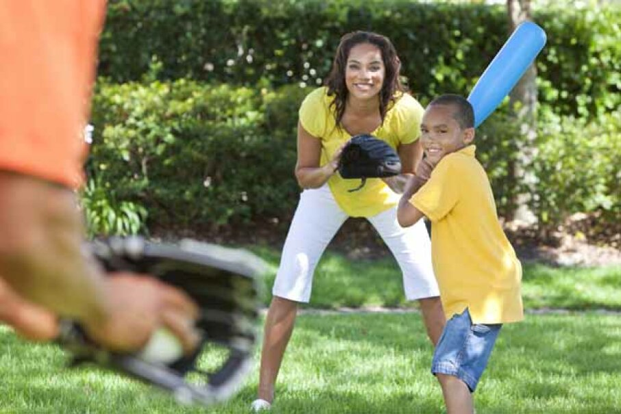 It's best to use plastic bats and balls when playing in the backyard. iStockphoto/Thinkstock
