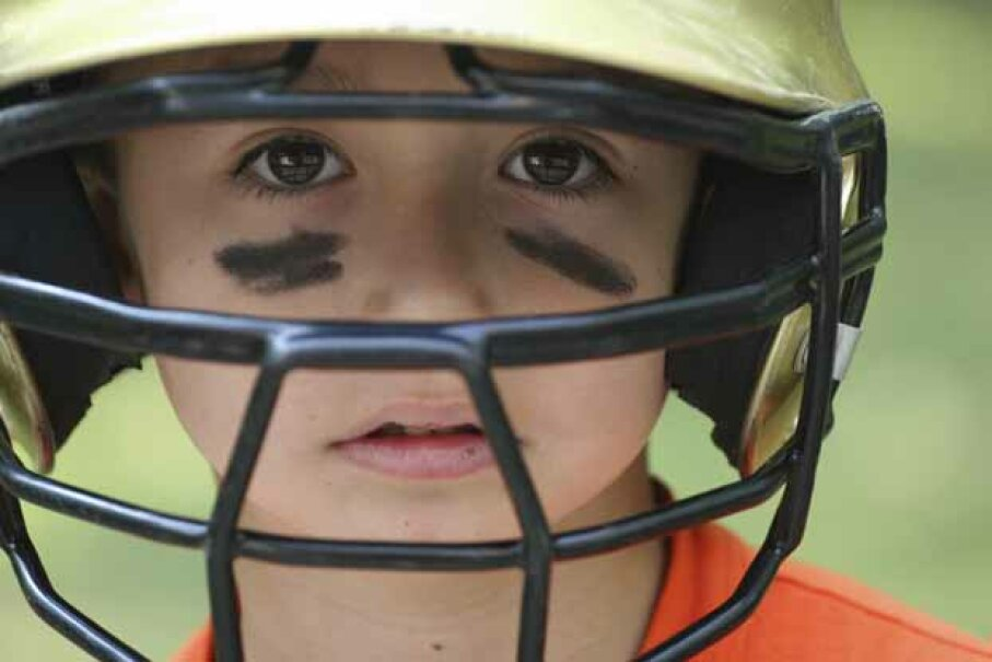 Kids should wear batting helmets with a metal cage to fully protect their faces. iStockphoto/Thinkstock