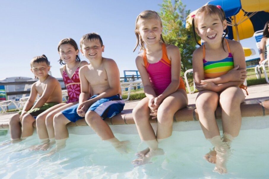 It's no secret that kids love pool time, so let them enjoy -- always with adult supervision. ©Creatas/Thinkstock