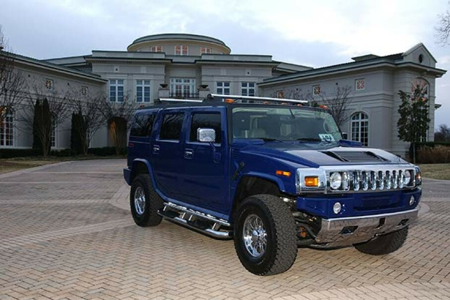 A custom-made Humvee sits outside Evander Holyfield's former 109-room mansion in Georgia. Vince Bucci/Getty Images
