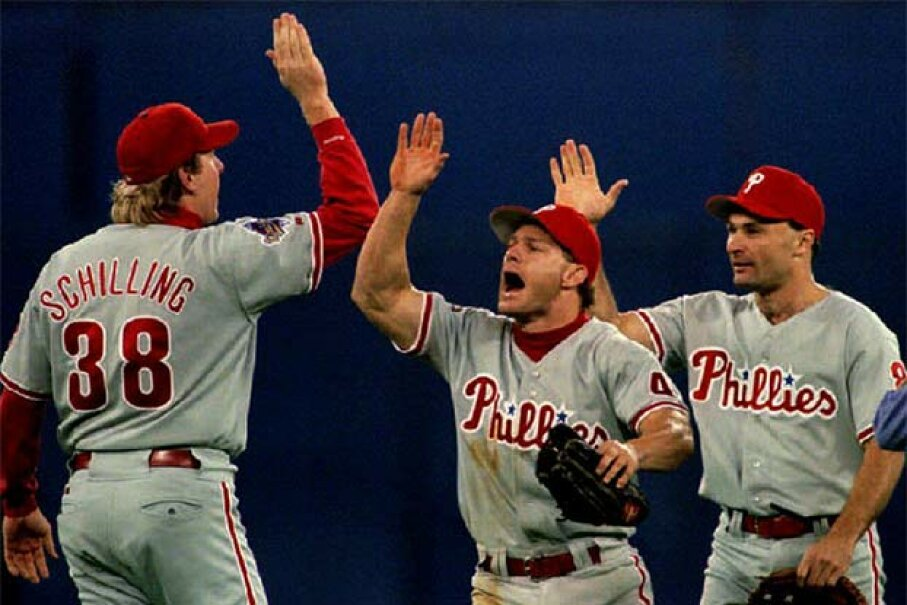 Philadelphia Phillies centerfielder Lenny Dykstra (C) high-fives pitcher Curt Schilling after the Phillies won Game 2 of the World Series in 1993. Dykstra later promoted himself as financial guru -- but still went bankrupt. TIM CLARY/AFP/Getty Image