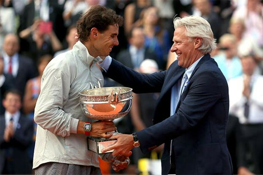Bjorn Borg (R) presents the winning trophy at the 2014 French Open to Rafael Nadal. Now out of bankruptcy, Borg has a successful clothing line. Matthew Stockman/Getty Images