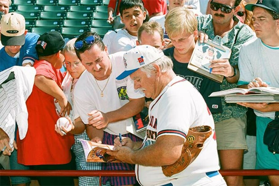 Gaylord Perry signs autographs during the 1995 All Star Weekend in Arlington, Texas. Sporting News via Getty Images