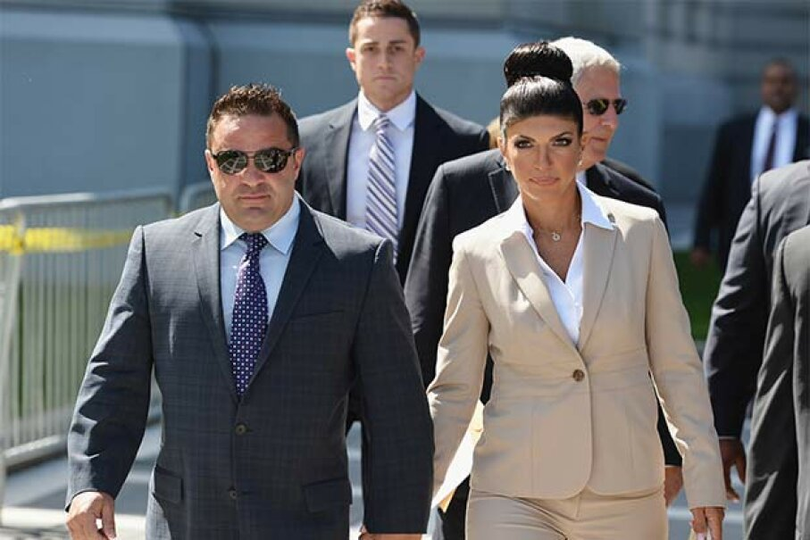 Giuseppe 'Joe' Giudice (L) and wife Teresa Giudice (of 'The Real Housewives of New Jersey') leave court after facing charges of defrauding lenders, as well as allegedly hiding assets and income during a bankruptcy case in 2013. Mike Coppola/Getty Images