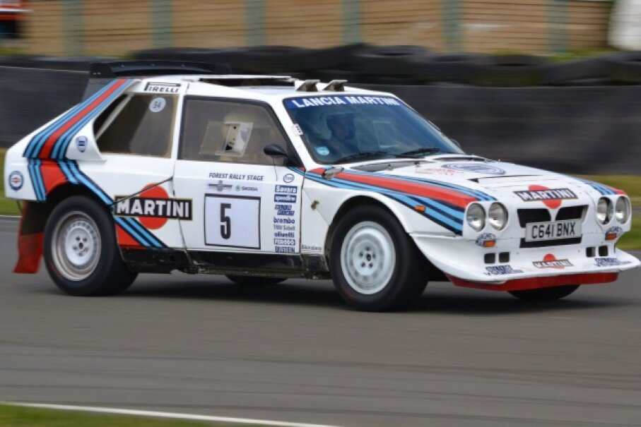 The Lancia Delta S4 is on a racetrack.