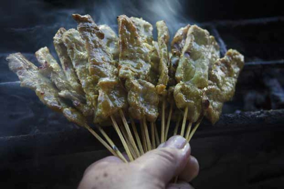 Here's  a shot of freshly prepared pork satay at a street vendor in the Thai capital of Bangkok. Yvan Cohen/LightRocket via Getty Images