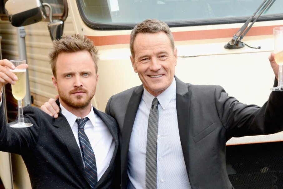 Aaron Paul and Bryan Cranston toast, probably to five successful seasons — the show won 16 Emmys. Mark Davis/Getty Images
