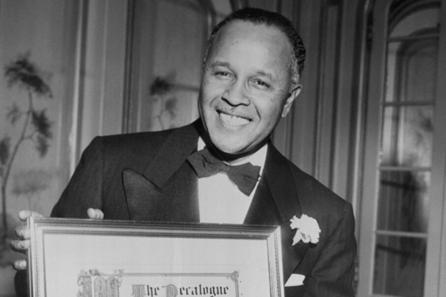 Pioneering chemist Percy Julian holds an award from the Decalogue Society of Lawyers, ca. 1950s. © Bettmann/CORBIS