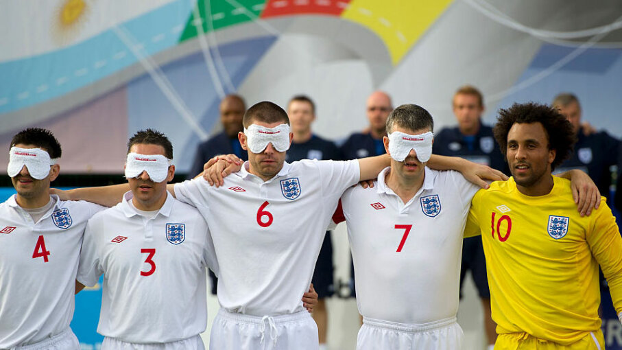 England's blind football team poses for a photo at the 2010 IBSA World Blind Football Championship in England. Rules dictate that the visually impaired players must wear blindfolds but the goalkeeper may be sighted. AMA/Corbis via Getty Images