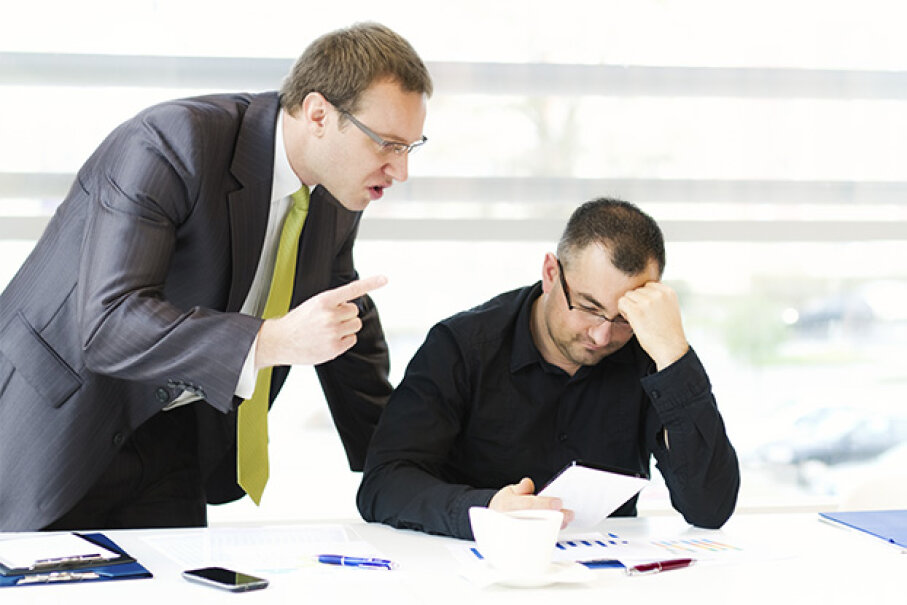Invading your employee's space to berate him is just not good boss etiquette. ajkkafe/iStock/Thinkstock