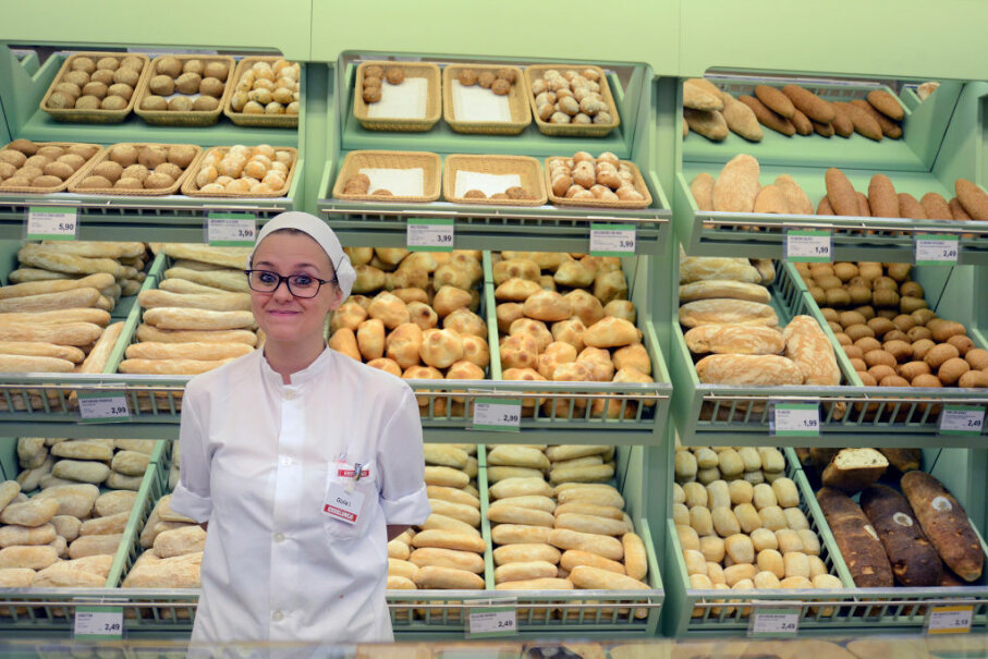 A member of the sales staff stands in the bakery section as Italian supermarket chain Esselunga opens its first store in Rome, 2017. A wide variety of breads are stocked there. Simona Granati/Corbis via Getty Images
