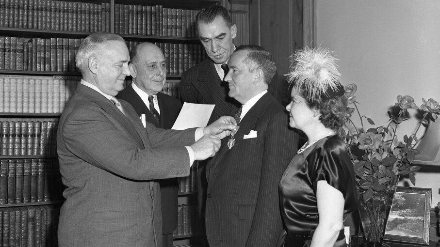 Bill Donovan, wartime chief of the Office of Strategic Services, pins a medal on William Stephenson, director of British Security Coordination. Bettmann/Getty Images