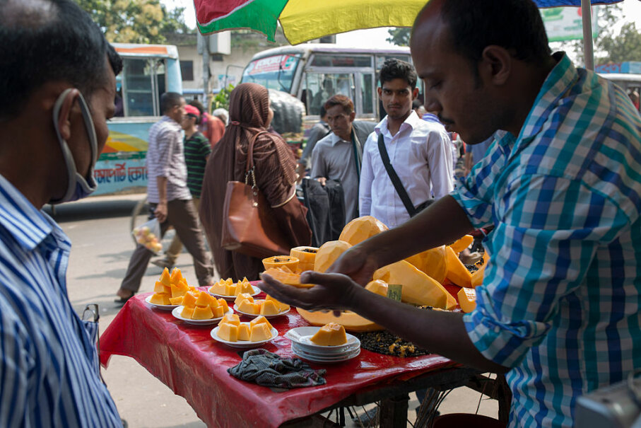 A vendor sells food on the street in Dhaka, Bangladesh, on Oct. 15, 2016. Most food sold on street corners in developing nations may not be safe for tourists to eat.  Zakir Hossain Chowdhury/NurPhoto via Getty Images