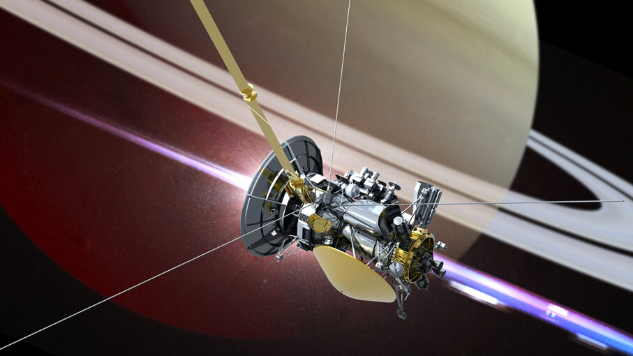An artist's illustration shows the Cassini spacecraft in orbit around Saturn. Victor Habbick Visions/Science Photo Library/Getty Images
