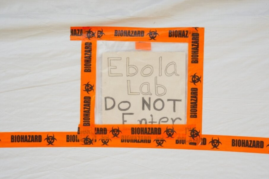 As this picture shows, the Centers for Disease Control and Prevention isn't just working with deadly agents at headquarters in Georgia. This sign sticks to the sample processing area of the CDC Ebola lab in Bo, Sierra Leone. © David Snyder/ZUMA Press/Corbis