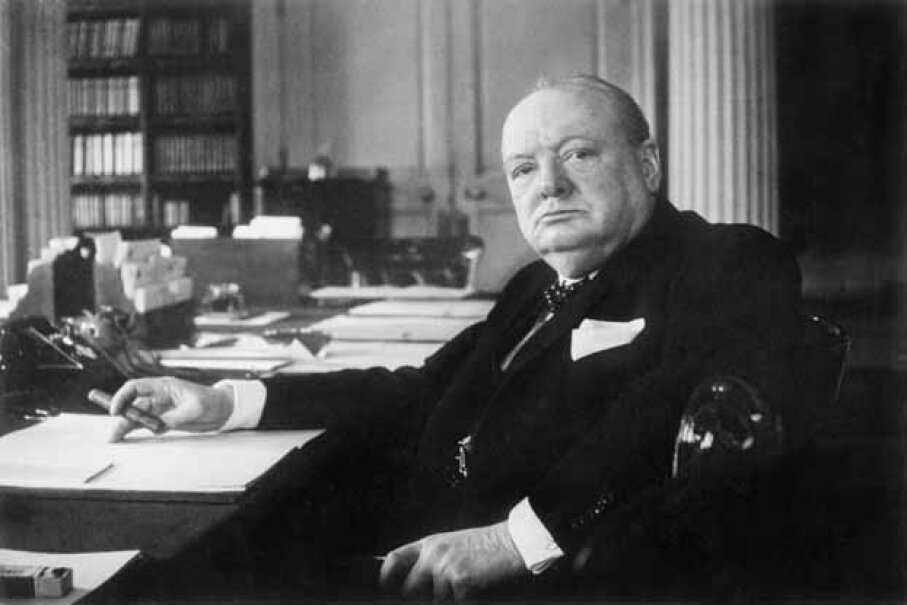 Prime Minister Winston Churchill, photographed at 10 Downing Street wearing his trademark bowtie and holding his usual cigar. Cecil Beaton/IWM via Getty Images