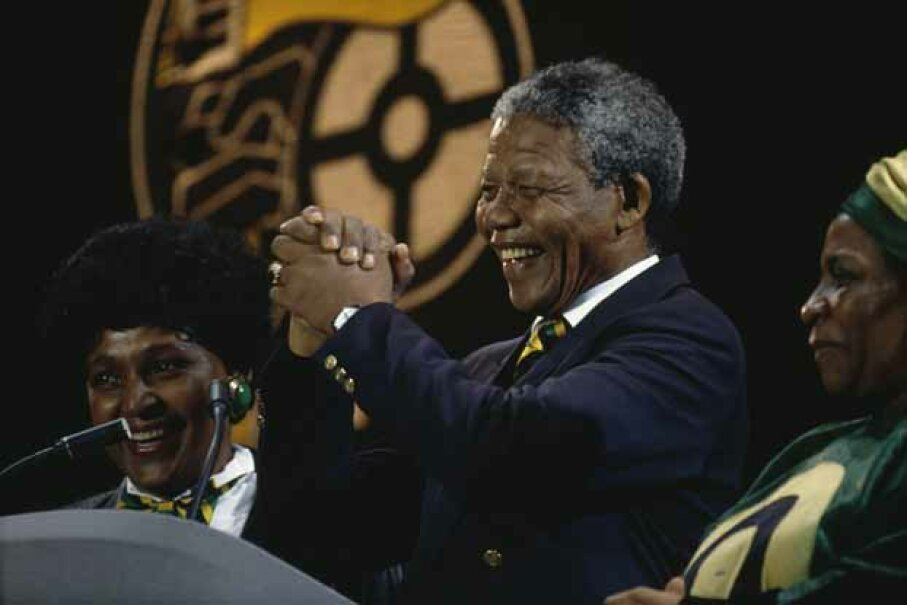Nelson Mandela and his then-wife Winnie (left) attend a concert at Wembley Stadium to celebrate his release from prison in 1990. Georges De Keerle/Getty Images