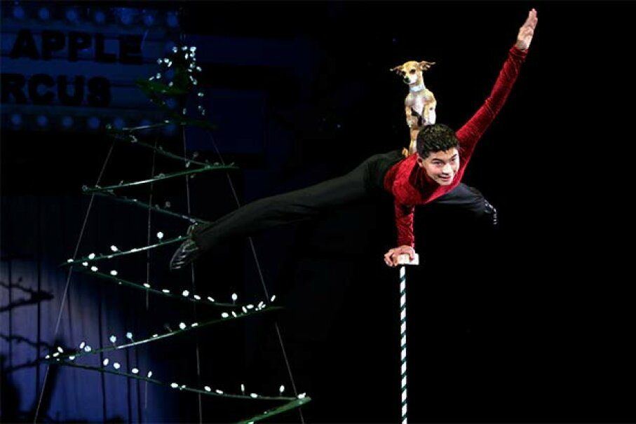 Christian Atayde Stoinev performs his hand-balancing act with his dog Scooby at the age of 14 at the Big Apple Circus. Hiroyuki Ito/Getty Images