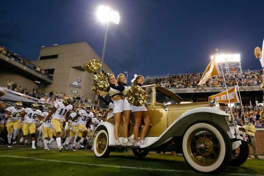 The Ramblin Wreck leads the Georgia Tech Yellow Jackets onto the field in Atlanta. Georgia Tech is a public college with an excellent reputation and a full tuition of only $8,258 for in-state students in 2013-14. Kevin C. Cox/Getty Images