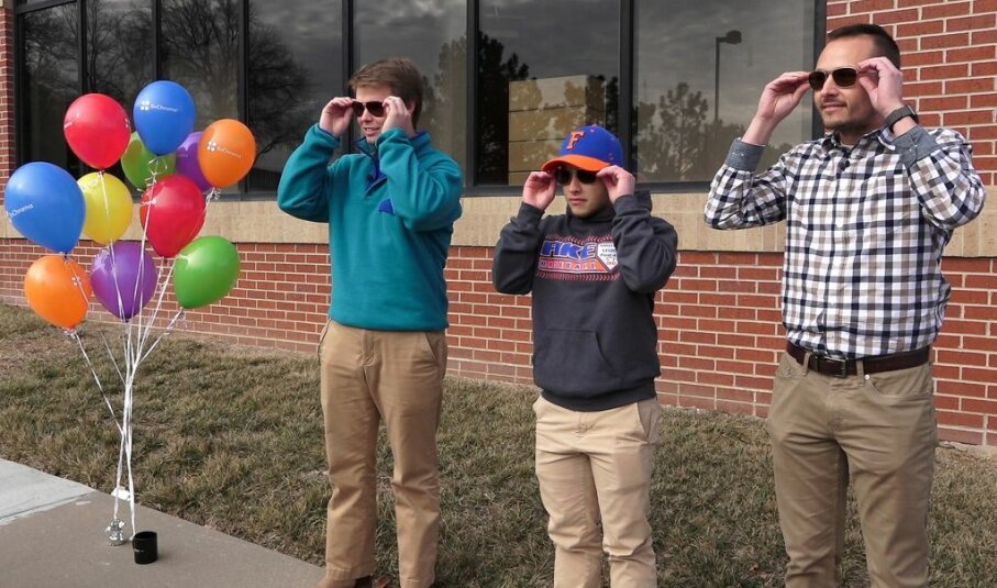 A teen and two men with color blindness in Mission, Kansas, try on special EnChroma glasses. The lenses allow the wearer to experience more color saturation and see better detail and depth. Jill Toyoshiba/Kansas City Star/TNS via Getty Images