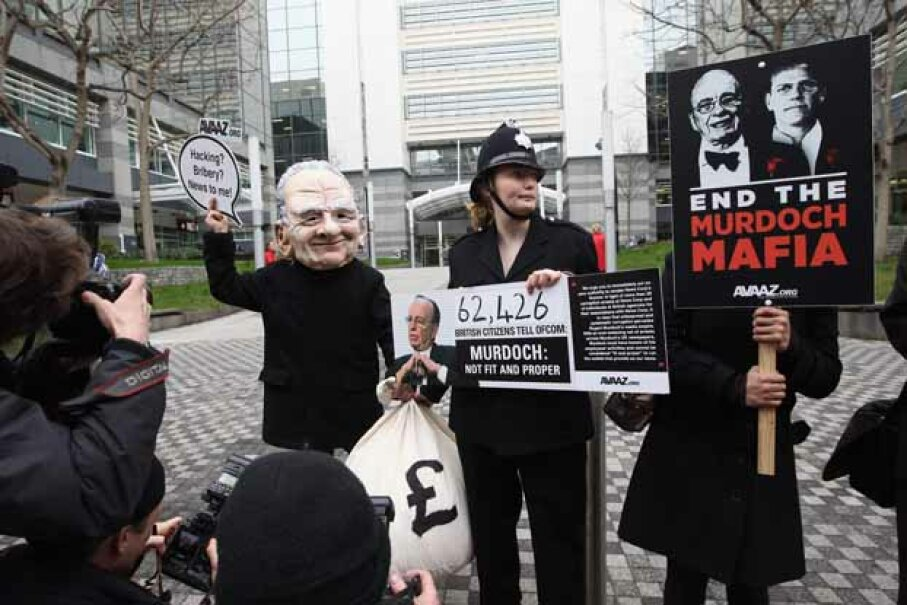 A small protest against Rupert Murdoch was held outside the Thomas More Square News International offices in London after five journalists from The Sun were arrested during the Fleet Street Scandal. Dan Kitwood/Getty Images