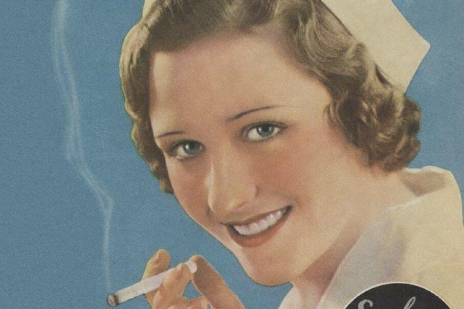 A 1930's magazine ad shows a nurse enjoying a cigarette. © Blue Lantern Studio/Corbis