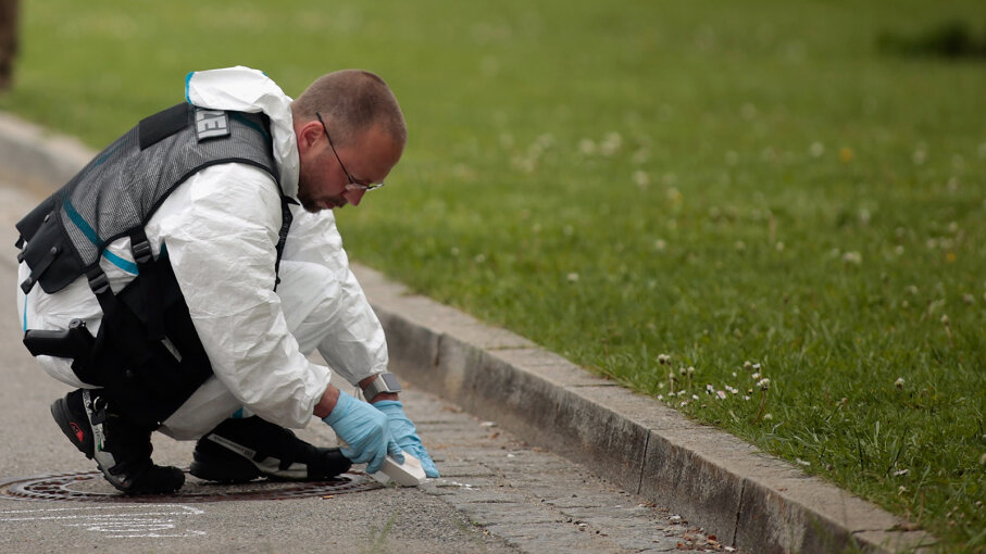 Forensic specialists of the German police secure the crime scene