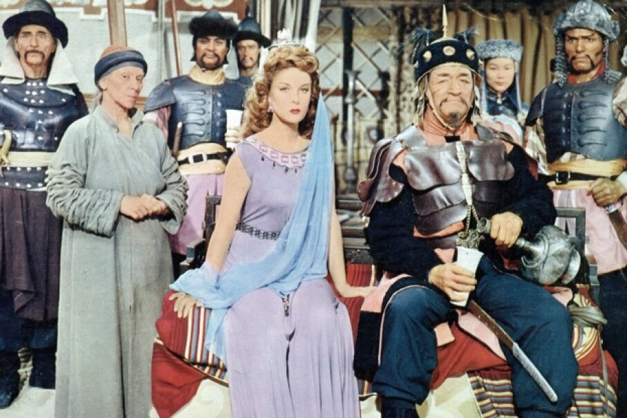 "Susan Hayward, John Wayne and assorted other actors in ""The Conqueror"" RKO Radio Pictures/Getty Images"