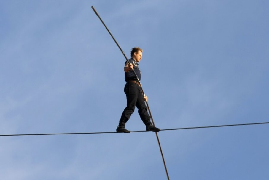 Nik Wallenda continues the family tradition by walking on a high wire over Newark, New Jersey. © Patti Sapone/Star Ledger/Corbis