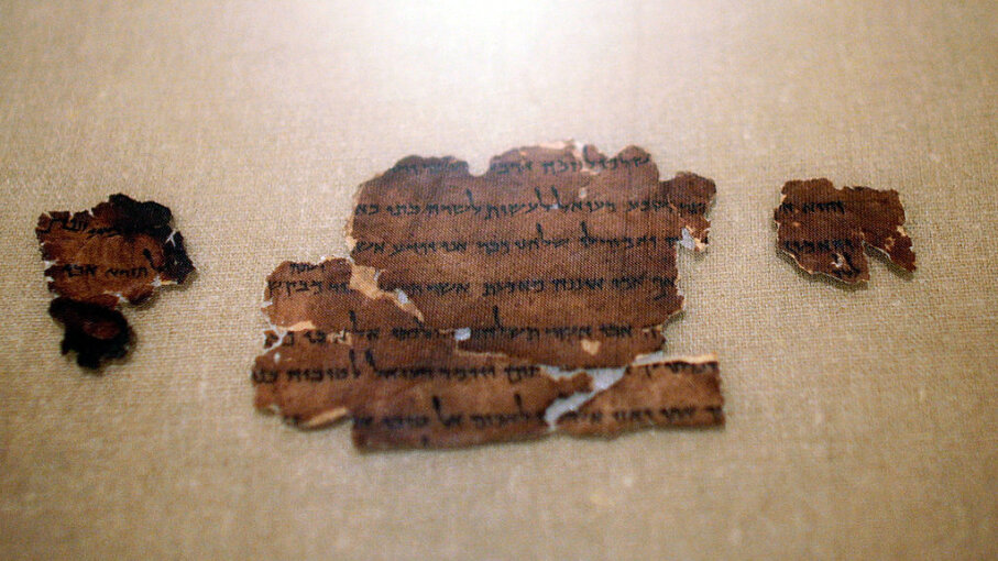 "A 2,000-year-old fragment from the Dead Sea Scrolls is seen on display at The Jewish Museum in New York City in the 2008 exhibit ""The Dead Sea Scrolls: Mysteries of the Ancient World."" Chris Hondros/Getty Images"