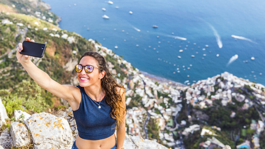 woman taking selfie on cliff