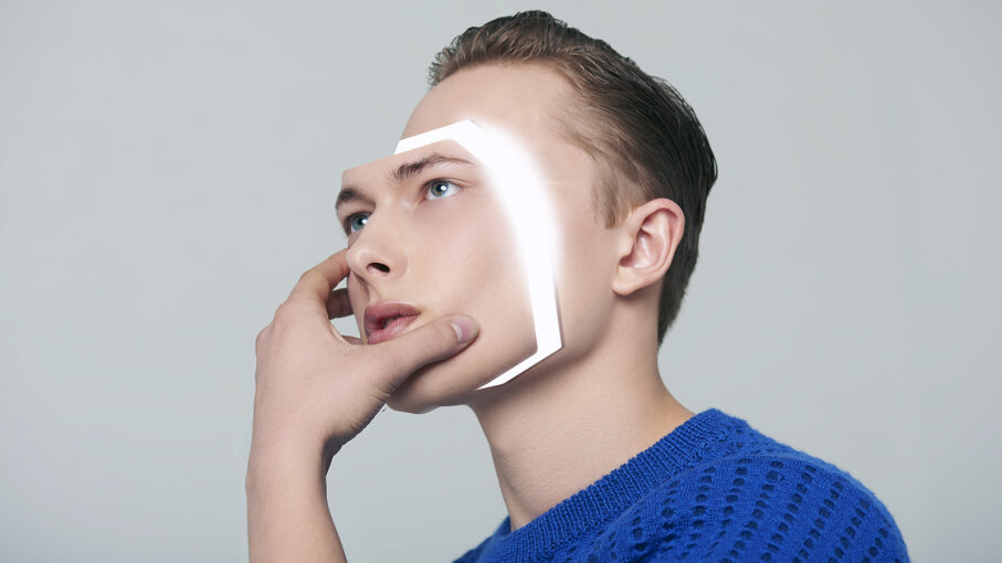 man removing face
