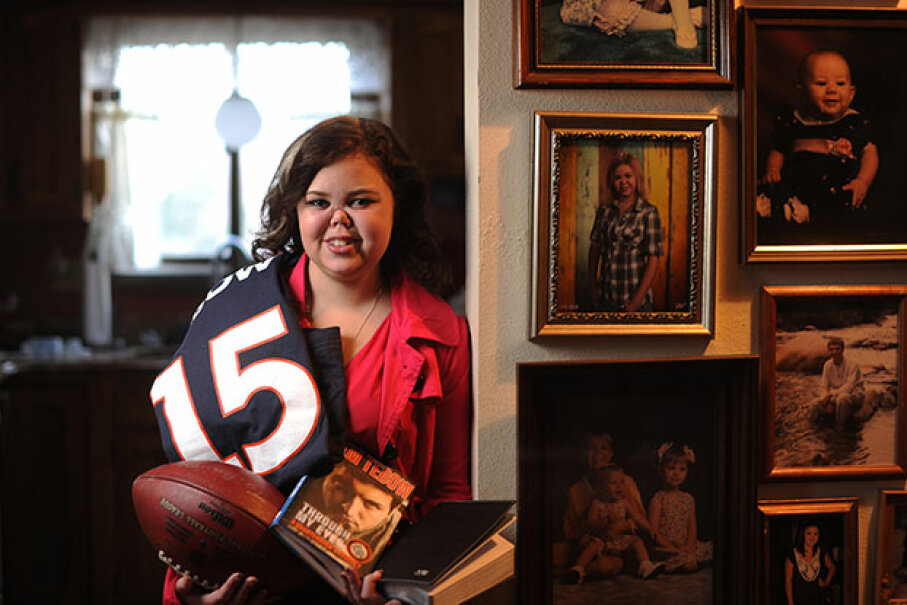 Sixteen-year-old Bailey Knaub poses with some of the items she received after a visit with Tim Tebow. Knaub has endured 73 surgeries since being diagnosed with Wegener's Granulomatosis at age 7. Cyrus McCrimmon/The Denver Post via Getty Images