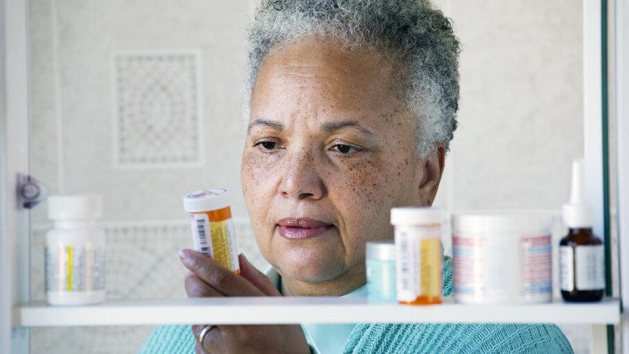 woman checking prescriptions