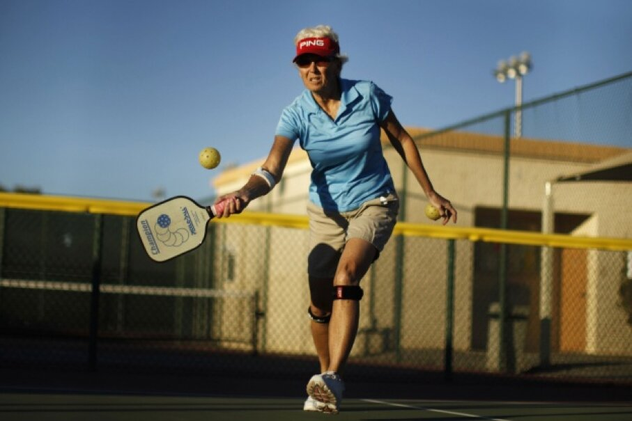 Pickleball is played with a paddle and a ball similar to the ones used for whiffleball. No actual pickles are involved. © LUCY NICHOLSON/Reuters/Corbis