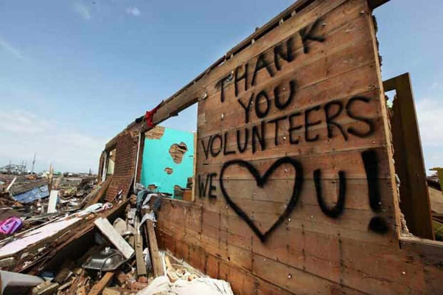 "A ""thank you"" message to volunteers is seen on the side of a building after a massive tornado in Joplin, Mo. that killed 161 people. Volunteers are appreciated in disasters, but it's best that they have training in disaster response. Mario Tama/Getty Images"